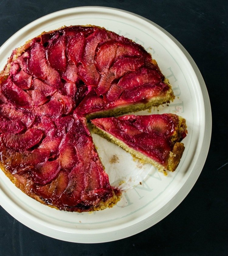 This lovely Vegan Polenta Cake is topped with juicy plums - a lovely teatime treat #vegan #plantbased #veganfood
