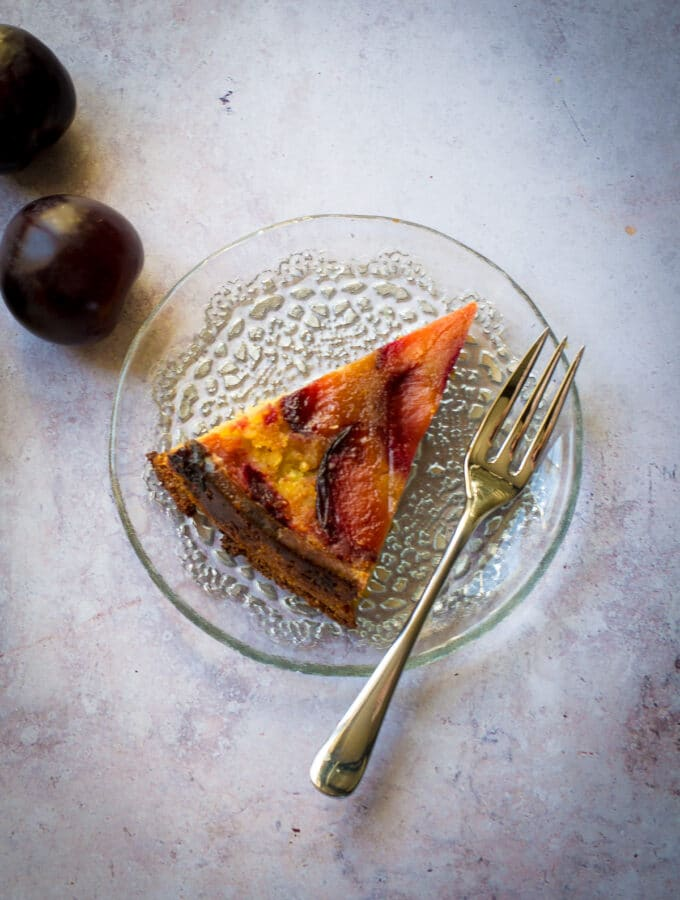 Slice of plum upside-down cake (vegan)