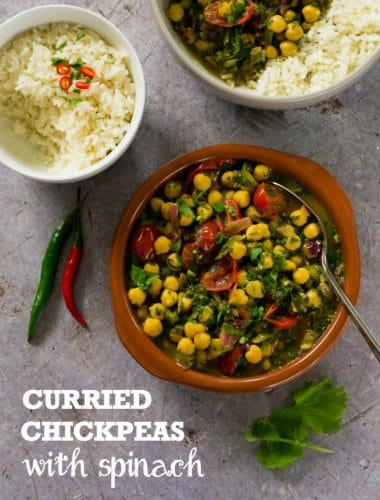 These speedy curried chickpeas and spinach make an easy but flavour-packed weeknight supper. Service with rice or nan breads. #vegan #plantbased #veganfood #vegetarian