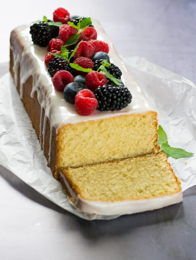 This Easy Vegan Lemon Cake is just so delicious, pretty to look at and simple to make, no one will ever guess it is vegan! #vegan #plantbased #veganfood #vegancake #veganbaking