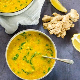 Vegan Lentil Soup bowl with ginger & turmeric - delicious comfort food recipe #vegan #plantbased #veganfood