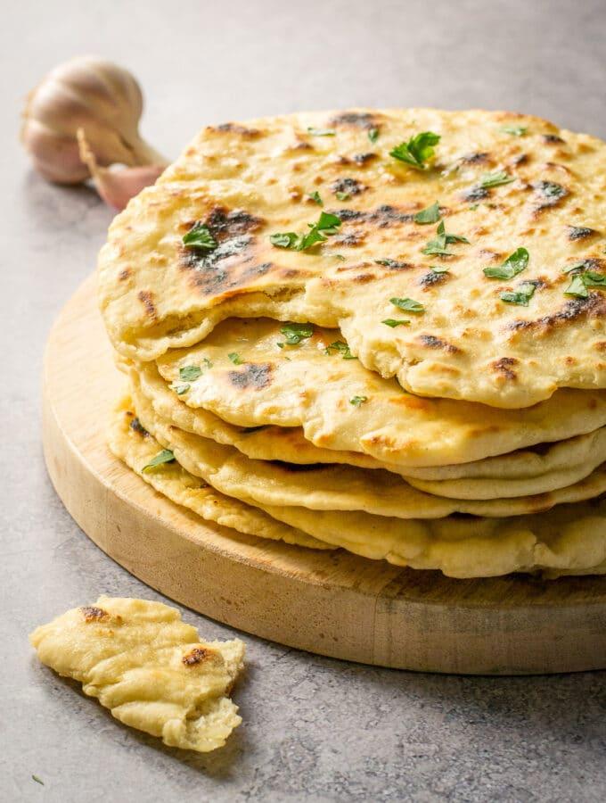 Flatbread Recipe Vegan - pile with chunk taken out