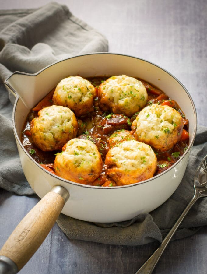 Vegan Stew with dumplings in a casserole dish with lid