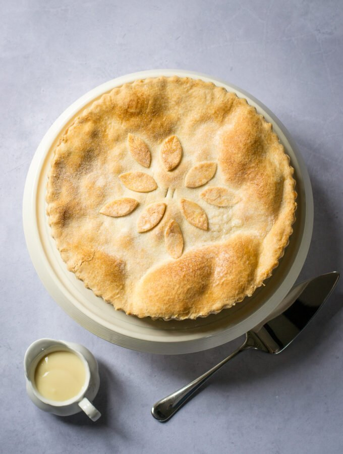 Whole Apple Pie with pastry decoration